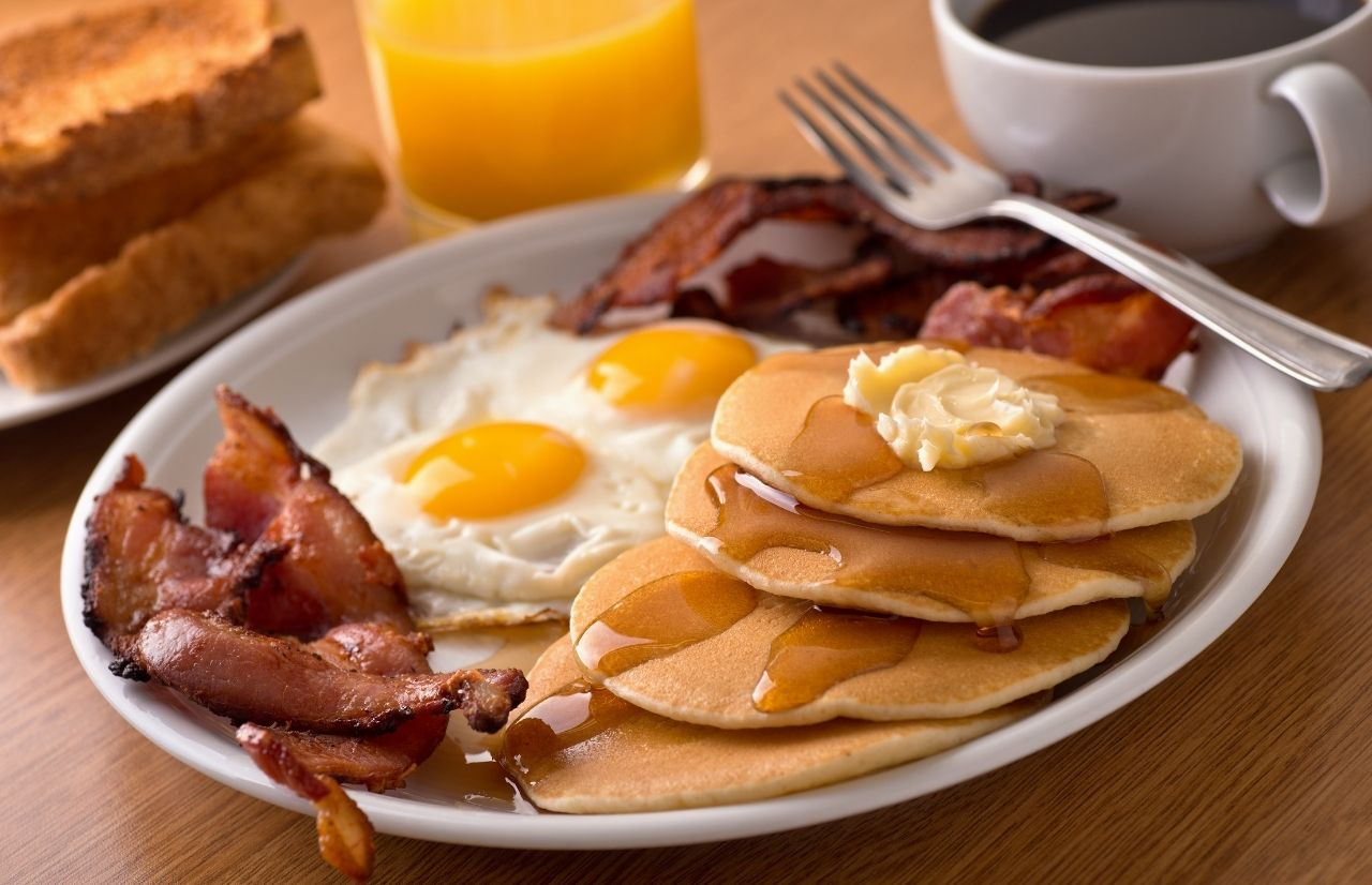Best Breakfast in Gainesville Florida with bacon pancakes and eggs